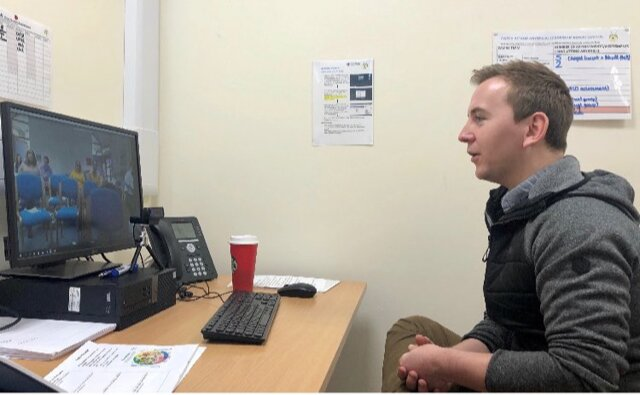 A GP using a video call to speak to patients