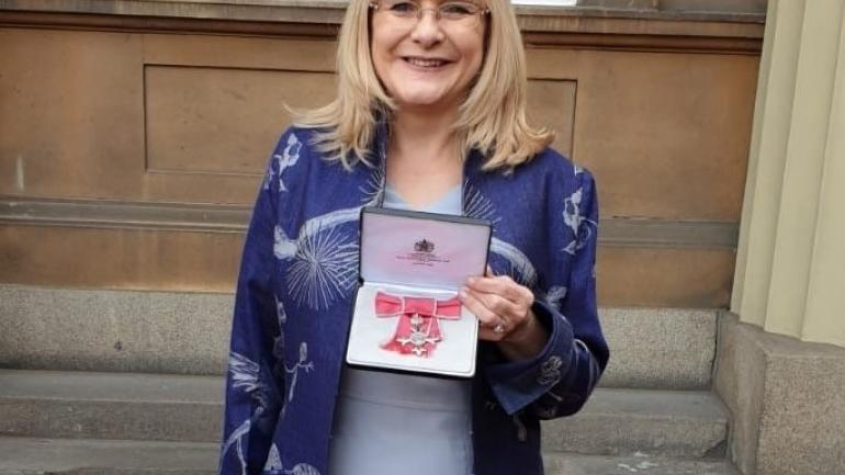 Image of Cath O'Brien with her MBE